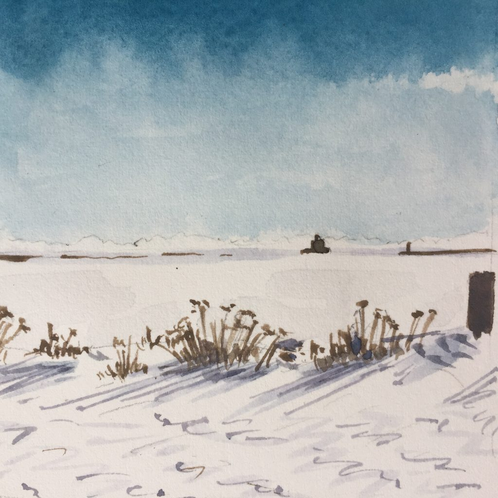 A landscape with a frozen lake and a distant lighthouse. In the foreground are some scrubby brown bushes.